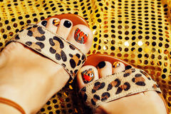 Photo of pedicure like butterfly design on gold background close up, mani pedi creative concept Stock Image