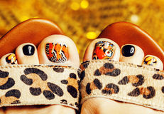 Photo of pedicure like butterfly design on gold background close up, mani pedi creative concept Stock Photography