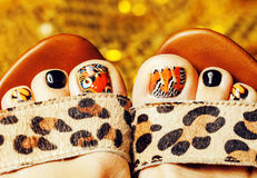 Photo of pedicure like butterfly design on gold background close up, mani pedi creative concept Stock Images