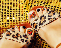 Photo of pedicure like butterfly design on gold background close up, mani pedi creative concept Stock Photo