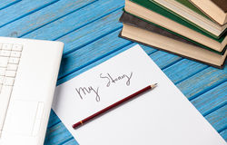 Photo of pencil, books, laptop and paper with My Story words nea Stock Image