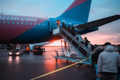 Photo of People Boarding Airliner royalty free stock image