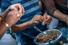 Photo of People Making Dumplings. Stock Photo