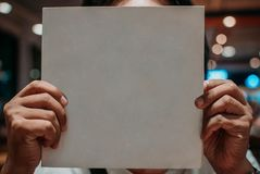 Photo of a person holding a blank white book for mock up and for commercial purposes. Photo of a person holding a blank book for mock up and for commercial Royalty Free Stock Images
