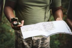 Photo of Person Holding Map and Compass royalty free stock images