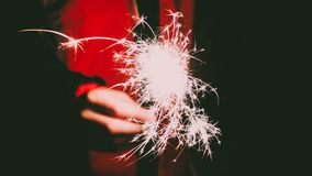 Photo of a Person's Hand Holding Firecracker stock image