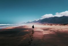 Photo of Person Walking on Deserted Island Stock Images