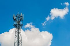 Phone tower antenna with blue sky and cloud background Royalty Free Stock Photography