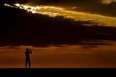 photo of a photographer in the sunset in madagascar Royalty Free Stock Images