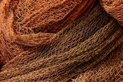 Close up view of fishing net. Photo Picture Close up view of colored fishing net stock photo