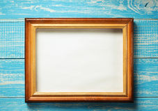 Photo picture frame on wood. En background Royalty Free Stock Photo
