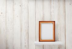 Photo picture frame at wooden shel. Photo picture frame at white wooden shelf Royalty Free Stock Photos