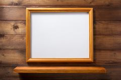 Photo picture frame and wall shelf. Photo picture frame and wooden wall shelf Royalty Free Stock Photos