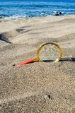 Magnify Glass on the Sand Beach. Photo Picture of a Loupe Magnify Glass on the Sand Beach Stock Photo
