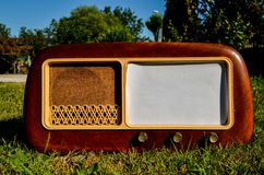 Old radio on a grass background Stock Photo