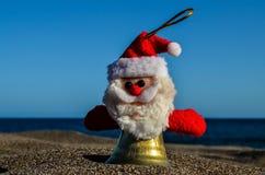 Santa Claus Toy on the Sand Beach. Photo Picture of Santa Claus Toy on the Sand Beach stock image