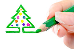 Photo picturing hands pencil a Christmas tree. On a white background Stock Photos
