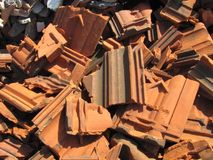 Photo of pile of broken bricks and roof tiles. Photo of pile of broken orange (red) bricks and roof tiles Royalty Free Stock Photo