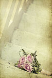 Photo of pink wedding bouquet on the stairs Royalty Free Stock Image