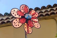 Photo of a colored Pinwheel toy Windmill garden Stock Photos
