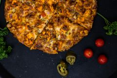 Photo of pizza taken from top. This is photo of pizza. with some of it`s ingredients Stock Images