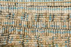 Photo of plastic bottles, they are recycled and used as a wall. Photo of plastic bottles, recycle as a wall Stock Images