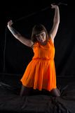 Photo of plump woman with whip Royalty Free Stock Photography