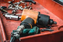 The photo of a pneumatic tool for car repairs royalty free stock photography
