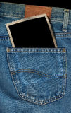 Photo in a Pocket of Blue Jeans Stock Images