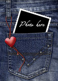 Photo in a pocket of jeans Royalty Free Stock Photography