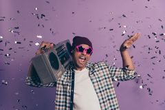 Photo portrait of crazy funny funky cheerful having free time student millennial making noise enjoying bass sound from royalty free stock images