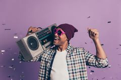Photo portrait of excited cool swag modern ecstatic carefree crazy funny funky student holding casette player radio on royalty free stock image