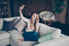Photo portrait of nice with toothy teeth beaming smile white caucasian charming gorgeous sh her lady housewife using. Telephone taking making self picture stock photo