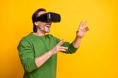 Free Photo Portrait Of Bearded Man Playing Game Virtual Reality Wearing Glasses Smiling Isolated On Vivid Yellow Color Stock Photo - 218083250