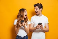 Photo of positive excited people man and woman screaming and loo. Photo of positive excited people men and women screaming and looking at each other while both stock images