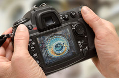 Photo of Prague astronomical clock on camera display during the city break travel. Stock Photos