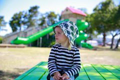 Photo of Pretty little girl in a striped shirt and a hat Royalty Free Stock Image