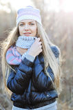 Photo of pretty woman in winter cap and scarf looking at camera Royalty Free Stock Photo