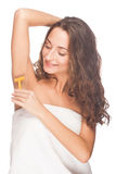 Woman shaving her armpits Stock Images