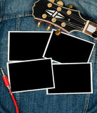 Photo prints and guitar Stock Images