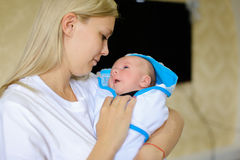 Photo profile portrait of woman and child portrait. Mum holds on Royalty Free Stock Photo