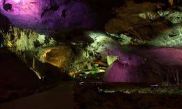 Photo Prometheus cave with beautifully illuminated stalactites and stalagmites Royalty Free Stock Image