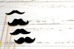 Photo props - black paper mustache on white vintage background stock photo