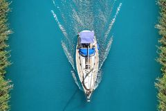 Photo prowl yachts from the top in the channel royalty free stock image