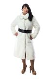 Photo of pudgy brunette in long white coat Stock Photo