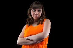 Photo of pudgy woman with arms crossed Stock Photo