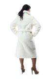 Photo of pudgy woman in long coat, from back. On white background Royalty Free Stock Images