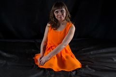 Photo of pudgy woman in orange dress Stock Photography