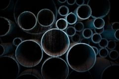 Photo PVC pipes stacked on old wooden board. Royalty Free Stock Photos
