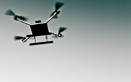 Photo of quadrocopter. Photo of a quadrocopter on sky stock photography